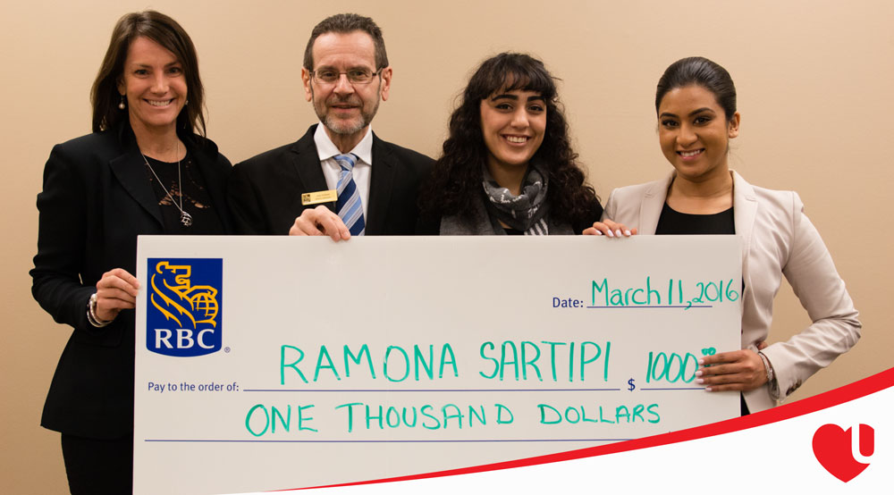 Ramona being presented with a giant check by the RBC staff.